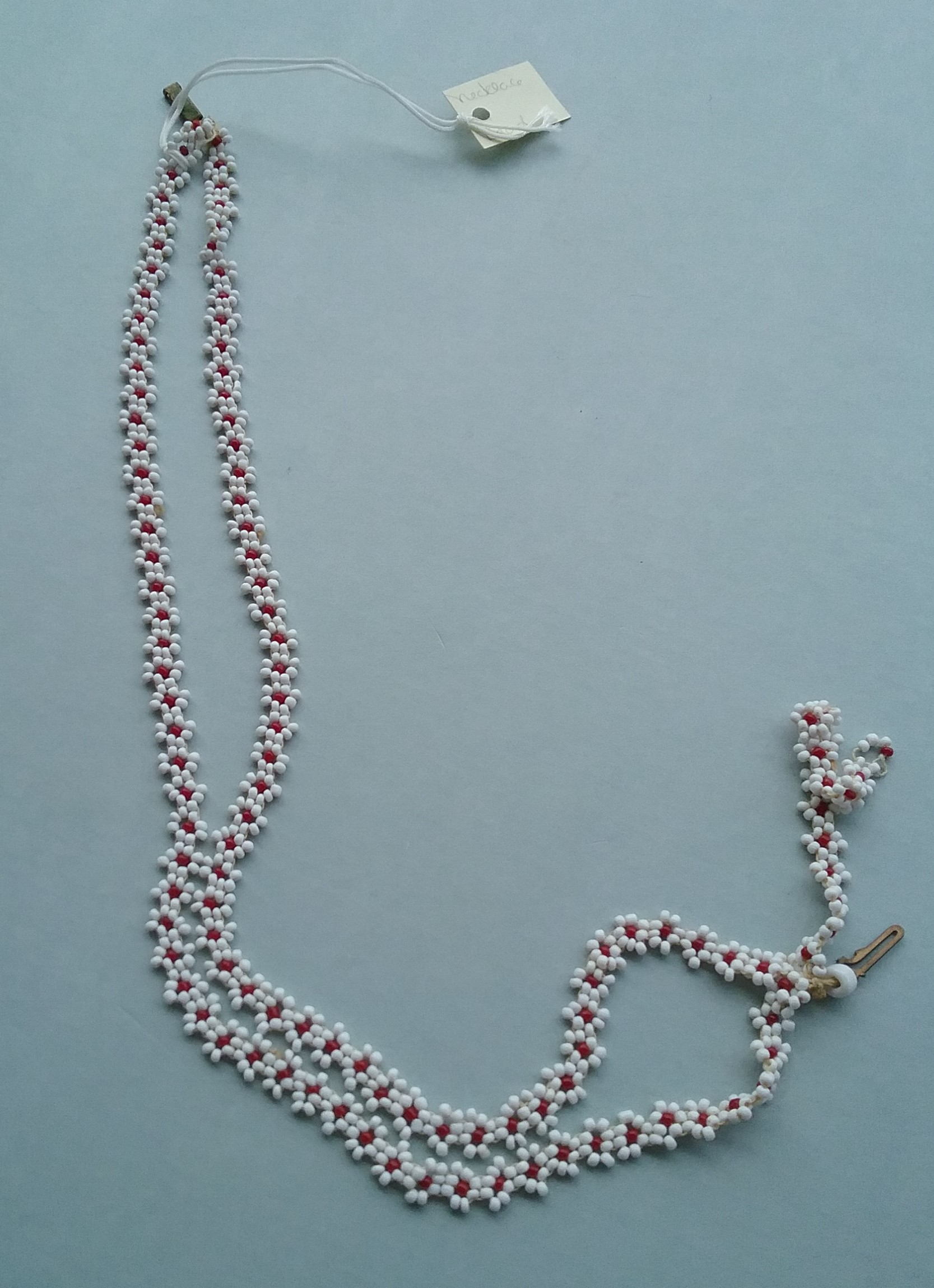 Seed Bead Necklace: This necklace features red and white seed beads. Donated by Doris Anderson. MCHS collections, #2004.87.1.