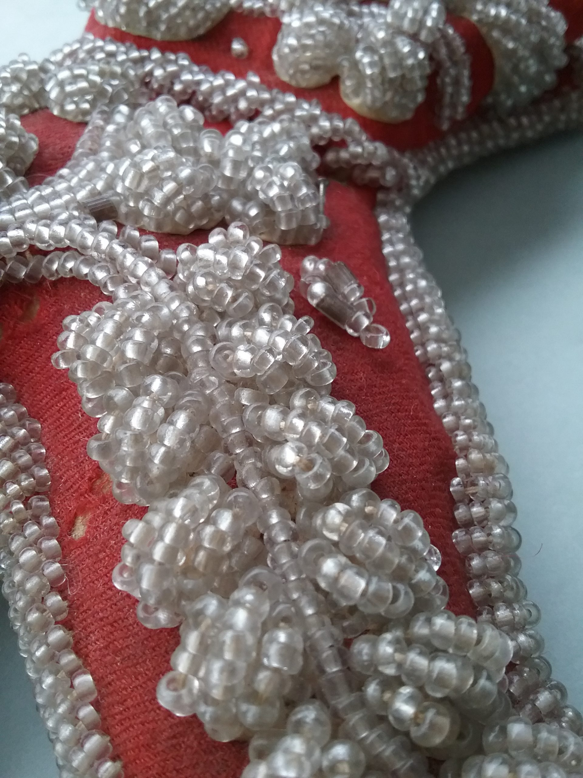 Detail on Small Red Beaded Shoe. MCHS collections, #1971.10.103.