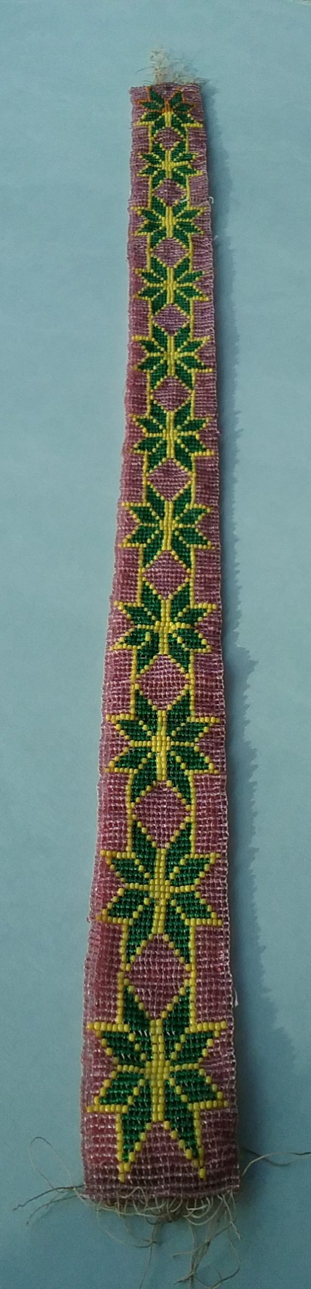 Beaded band: Loom-woven beaded band with pink, green, and yellow seed beads. From the Hill & Richardson store, c. 1870s. Donated by Mary (Richardson) Harker, daughter of Nathan Richardson. MCHS collections, #1945.76.9.