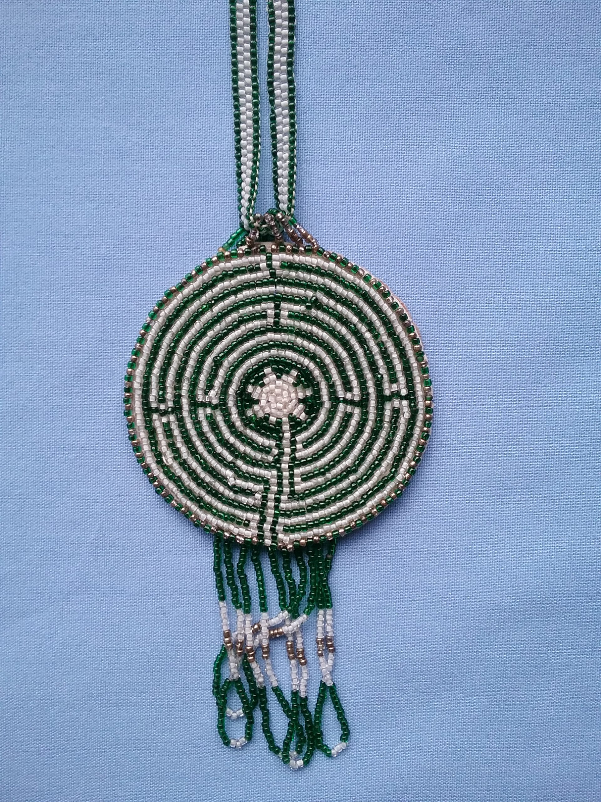Closeup of medallion on labyrinth necklace: On loan from Sister Carol Schmit, OSF.