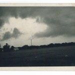 Before the storm. Eerie cloud formations of the storm as it headed into the Randall area. Looking northeast from County Road 6 near Lake Beauty. 1972 Flood, Morrison County, Minnesota. Photo by Gene Dubois for the Little Falls Daily Transcript. From the Morrison County Historical Society collections.