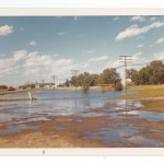Flood water receding. Photo taken following day after water was directed to Mississippi River along Cliffwood Motel in northeast Little Falls, 1972 Flood, Morrison County, Minnesota. Photo by Sister Karen Rausch. From the Morrison County Historical Society collections, #1977.57.1.o.