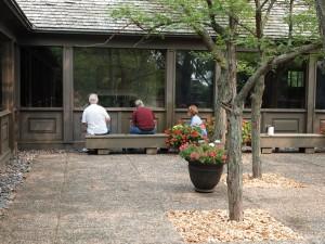 Weyerhaeuser Museum - 40th anniversary - August 2015 - Board members painting the courtyard panels.