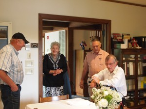 Weyerhaeuser Museum - 40th anniversary - August 2015 - Three board members and a guest.