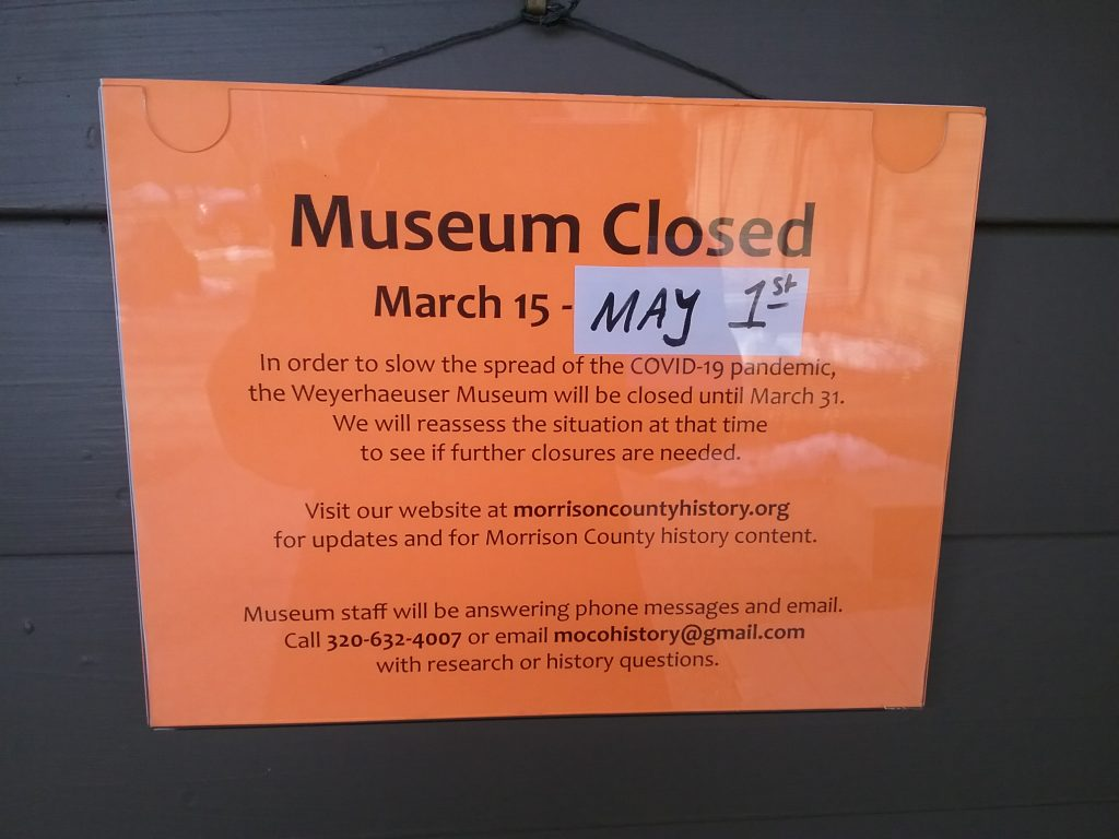Bright orange sign announcing the closure of the Weyerhaeuser Museum due to COVID-19, Little Falls, MN, March 26, 2020.