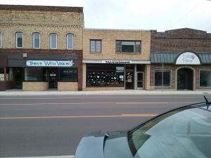 Black and white paper hearts in the windows of Little Falls Taekwondo, Little Falls, MN, April 15, 2020.