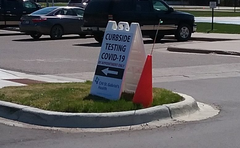 Closeup of Curbsite Testing COVID-19 sign at St. Gabriel's Hospital, May 12, 2020.