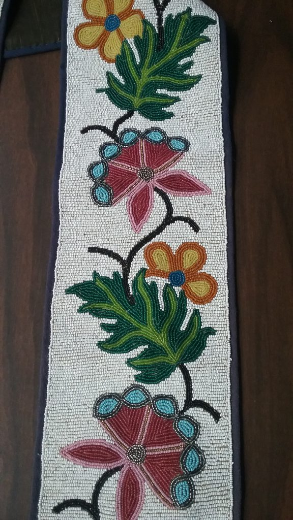 Closeup of right strap of the Ojibwe gashkibidaagan owned by Ethel Gourd Hall. MCHS collections, #1954.8.1.