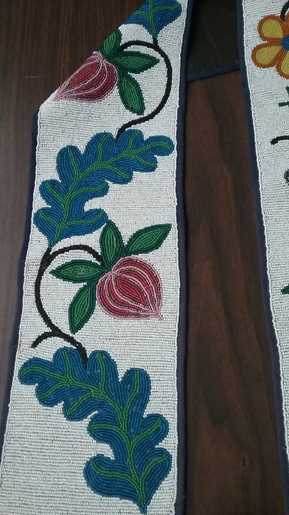Closeup of left strap of the Ojibwe gashkibidaagan owned by Ethel Gourd Hall. MCHS collections, #1954.8.1.