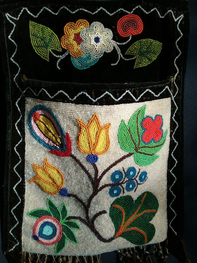 Detail of pouch on small Ojibwe gashkibidaagan. MCHS collections, #1996.36.3.
