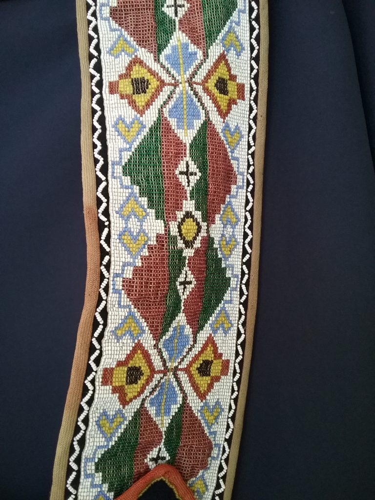 Detail of strap on Ojibwe gashkibidaagan owned by Nathan Richardson. MCHS collections, #1940.42.1.