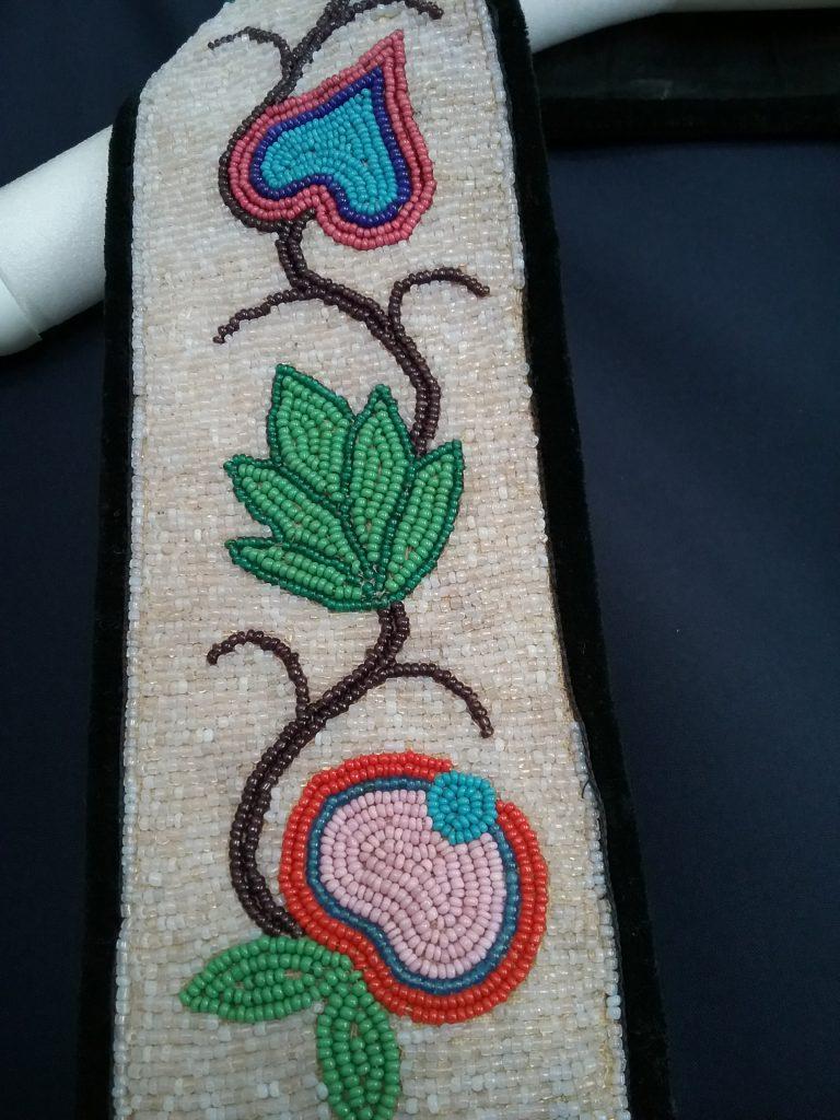 Closeup of beadwork on strap of small Ojibwe gashkibidaagan. MCHS collections, #1996.36.3.