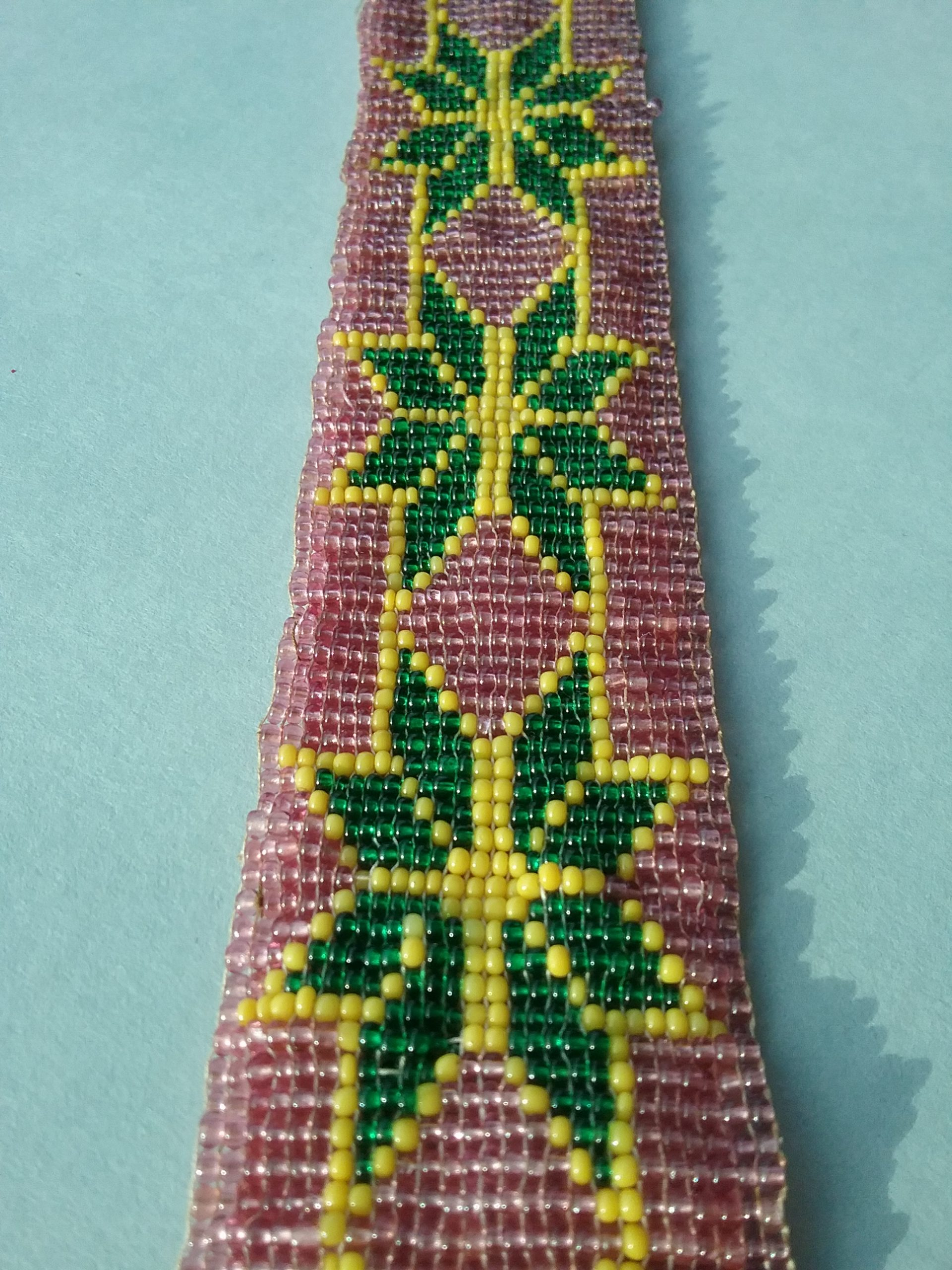 Closeup of beaded band: Loom-woven beaded band with pink, green, and yellow seed beads. From the Hill & Richardson store, c. 1870s. Donated by Mary (Richardson) Harker, daughter of Nathan Richardson. MCHS collections, #1945.76.9.