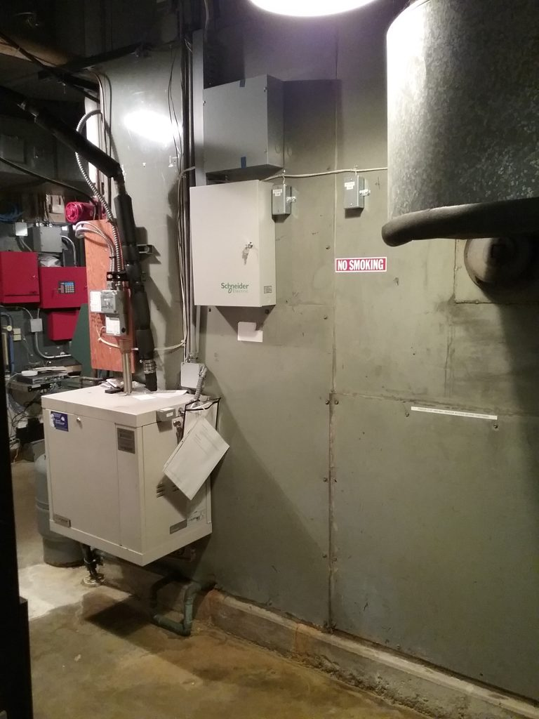 South side of the giant metal air handler with control panel (box near top center of photos) and humidifier (larger box on lower left). Note that the air handler is so large that it was impossible to get a photo of the entire system. Photo taken October 2, 2021.