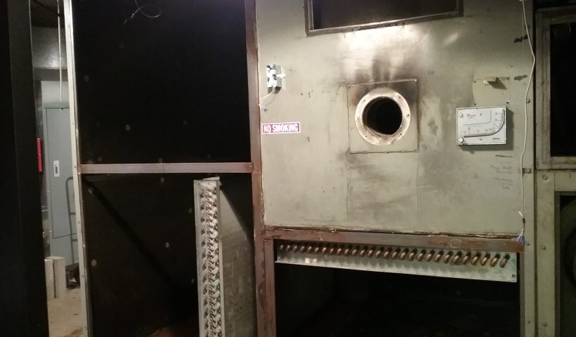 South side of the air handling unit with the control panel, humidifier, and side removed, exposing the large, dark cavities inside the air handler. Weyerhaeuser Museum, photo taken October 4, 2021.